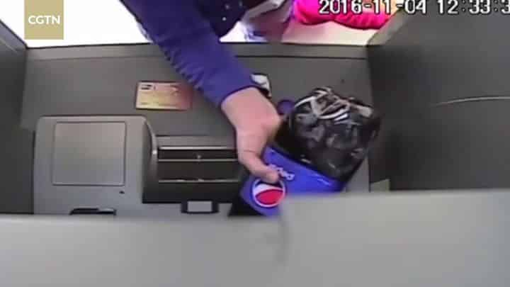 Woman Destroys ATM by Pouring Pepsi Into It